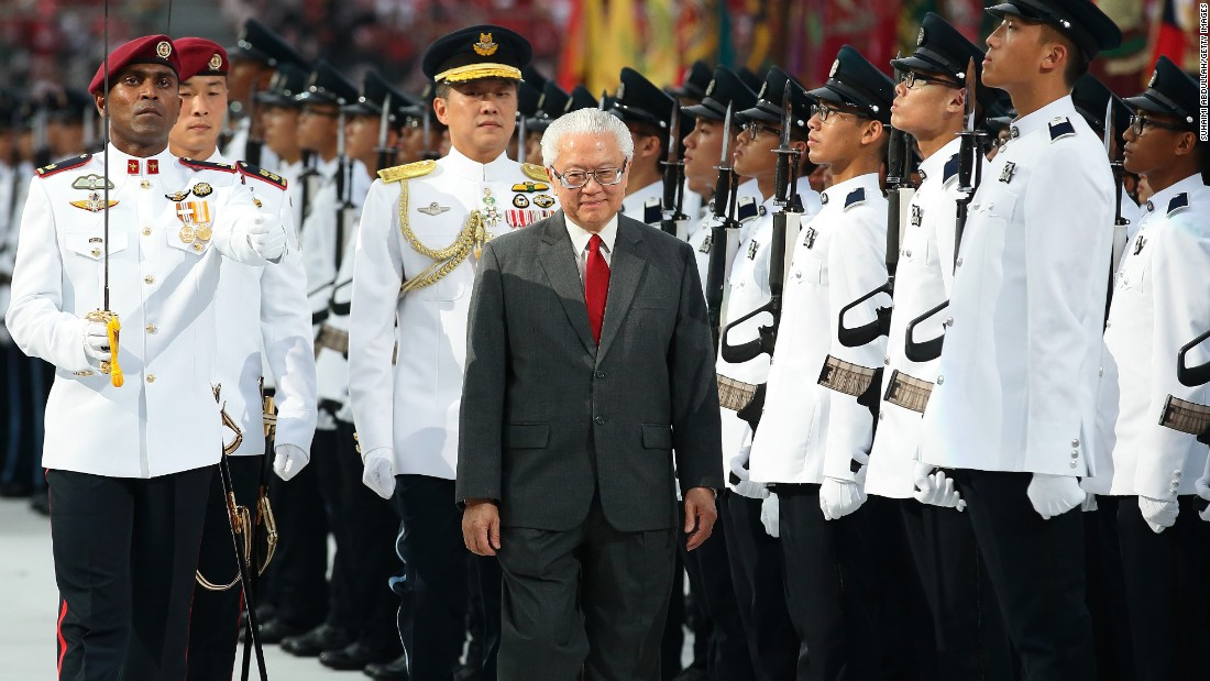 Singapore President Tony Tan Keng Yam  inspects the honor guard  during the National Day Parade on August 9.