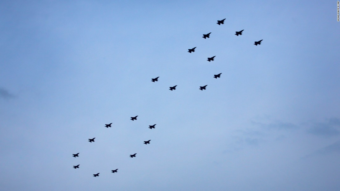 "Singapore's air force jets fly in a ""50"" formation as part of celebrations on August 9."