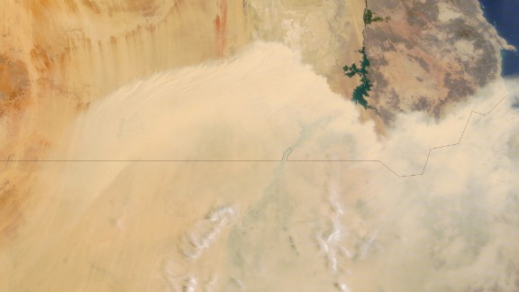 A wall of dust blows north from Sudan toward southern Egypt. This image was taken by NASA