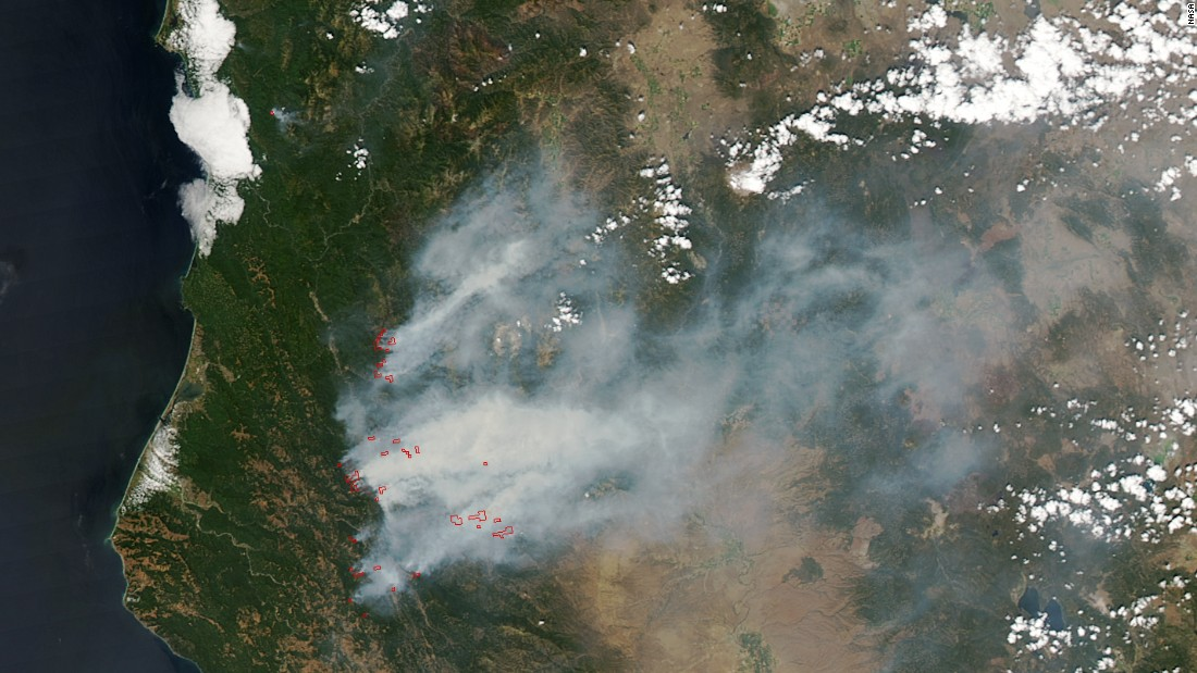 Large wildfires charred more than 6 million acres in the western U.S. in early August  That's nearly 2 million more than the 10-year average. About 80% of the burned area was in remote forests in Alaska, but large fires also scorched parts of Oregon, Washington and northern California. NASA's Aqua satellite took this image of wildfires burning in Oregon and California on August 5. Red outlines indicate the hot spots.