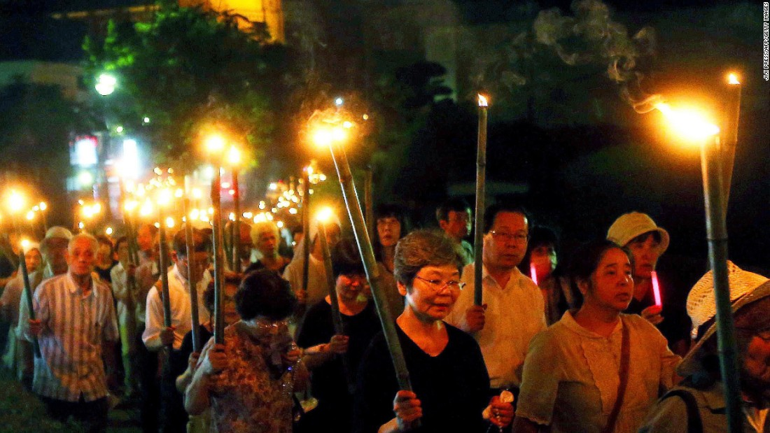 "Catholics hold bamboo torches during a peace march from the Urakami Cathedral toward the Peace Memorial park in Nagasaki, Japan, on Sunday, August 9, 2015. Seventy years ago, the United States <a href=""http://www.cnn.com/2015/08/04/world/gallery/atomic-bomb-hiroshima-nagasaki/index.html"" target=""_blank"">dropped atomic bombs on the cities of Hiroshima and Nagasaki.</a> The devastation led to Japan's surrender and brought an end to World War II."