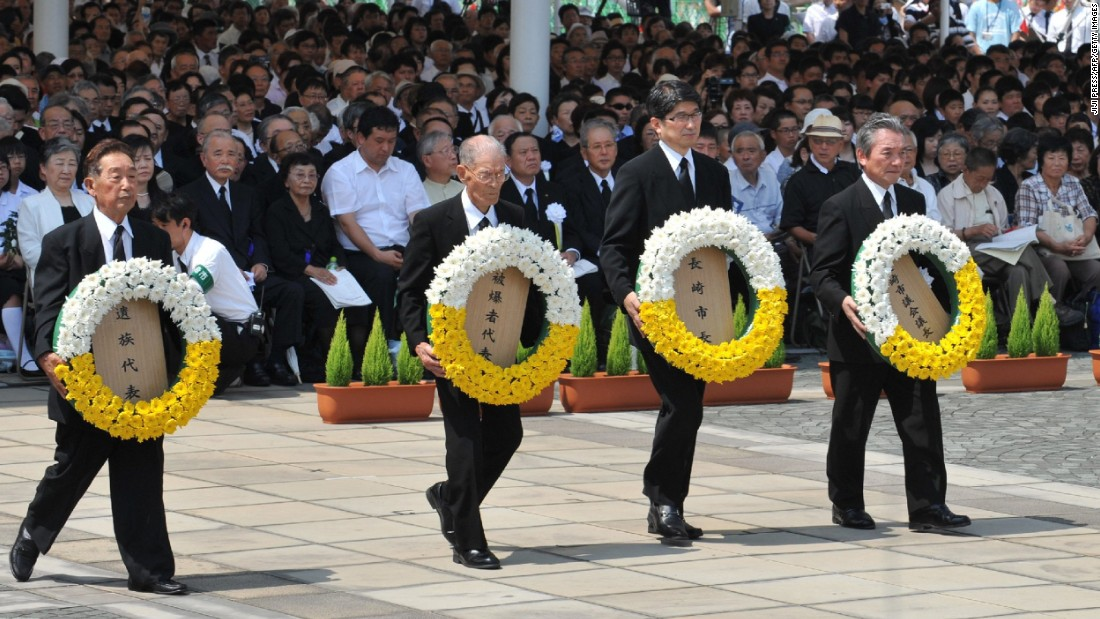 Nagasaki Mayor Tomihisa Taue, second right,  and other representatives offer wreaths of flowers during the memorial ceremony.