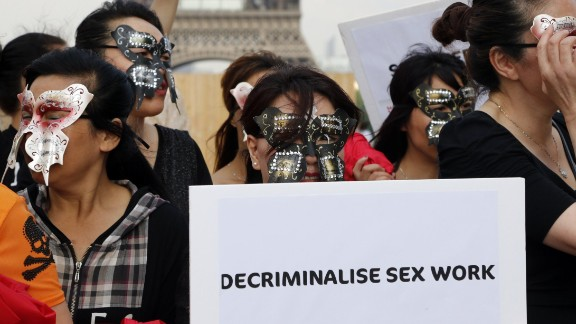 Sex workers take part in a June demonstration in Paris.
