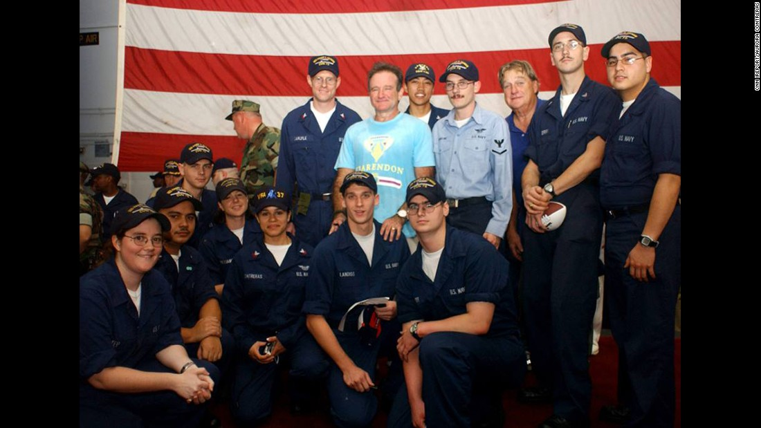 "<a href=""http://ireport.cnn.com/docs/DOC-1161067"">Aurora Contreras</a> of the U.S. Navy says meeting Robin Williams aboard the USS Harry S. Truman was one of her fondest memories from her 2004 deployment in the Persian Gulf. Contreras is shown kneeling to the left of the soldier whom Williams was standing behind. ""To see him there was a major highlight of our time onboard,"" she said."