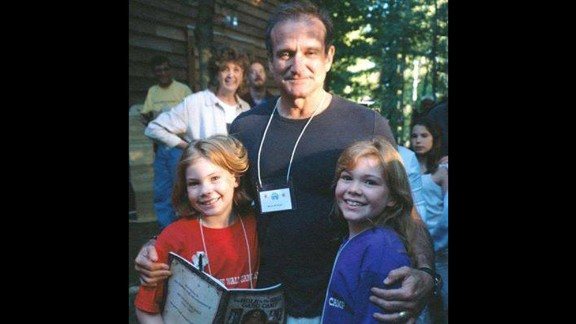 "At age 9, Stephanie Wilson, left, met Robin Williams while at a camp for sick children. In 1999, she got to perform with the comedian at a fundraising gala. ""He was hilarious. I wish he had known how much we appreciated him,"" she said."