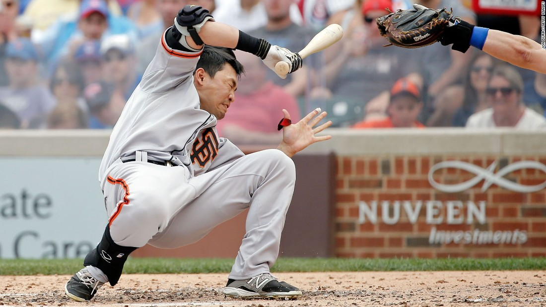 Nori Aoki of the San Francisco Giants reacts after being hit in the head by a pitch thrown by Chicago Cubs pitcher Jake Arrieta at Wrigley Field on Sunday, August 9, in Chicago.