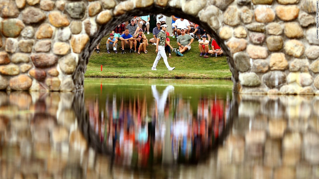 Kevin Na walks to the third green during the third round of the World Golf Championships-Bridgestone Invitational on Saturday, August 8, in Akron, Ohio.