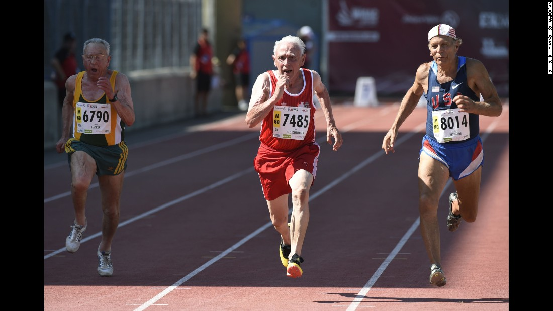 Switzerland's Hans Bloechlinger center, South Africa's Monty Hacker, left, and American Dick Richards run during the men's 80-years-old 100 meter final at the World Masters Athletics Championship on Friday, August 7, in Lyon, France.