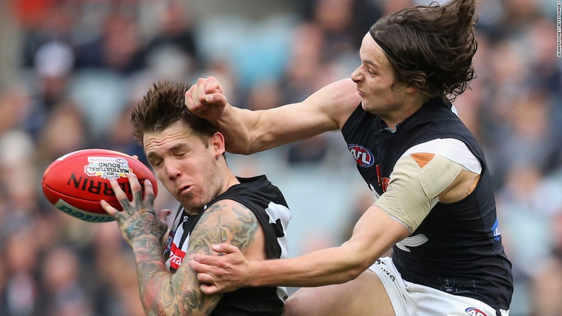Dane Swan of the Magpies marks in front of Dylan Buckley of the Blues as he attempts to spoil during the round 19 Australian Football League match on Saturday, August 8, in Melbourne, Australia.