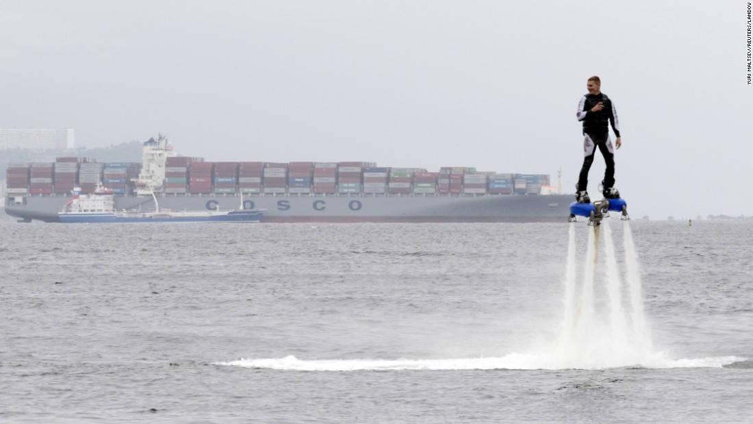 A performer rides a flyboard as part of a local cultural and sports festival in Vladivostok, Russia, on Friday, August 7.