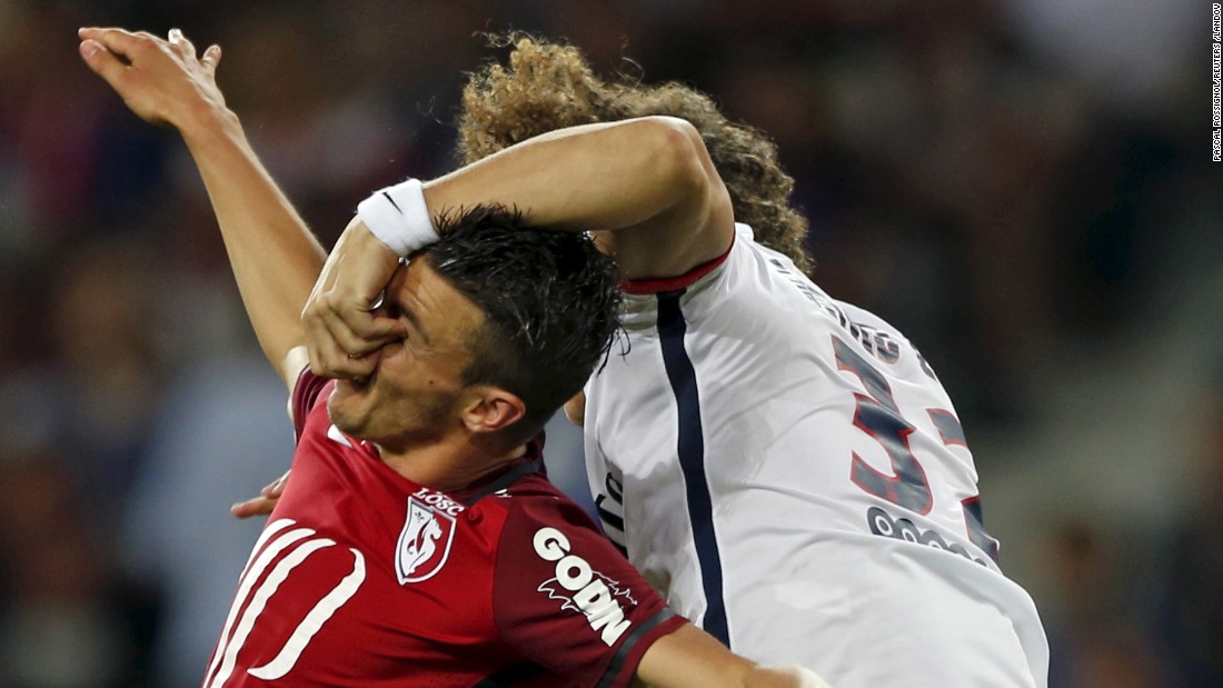 "David Luiz, right, of Paris Saint-Germain fights for the ball with Lille's Sebastien Corchia during their French Ligue 1 soccer match in Villeneuve d'Ascq, France, on Friday, August 7. <a href=""http://www.cnn.com/2015/08/04/sport/gallery/what-a-shot-sports-0804/index.html"">See 40 amazing sports photos from last week</a>"