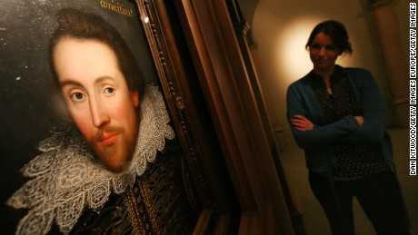 STRATFORD-UPON-AVON, ENGLAND - APRIL 17:  An employee of The The Shakespeare Birthplace Trust poses with a portrait of William Shalespeare on April 17, 2009 in Stratford-upon-Avon, England. The recently discovered painting, which is believed to date from around 1610, depicts Shakespeare in his mid-forties, and is believed to be the only authentic image of Shakespeare made during his life.  (Photo by Dan Kitwood/Getty Images)