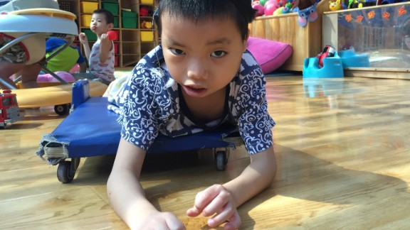 """Hai Cong was born in Guangxi province in southern China in 2009. He started living in Alenah's Home, run by Children's Hope, in July, 2014. Hai Cong suffers from atresia aural -- the absence or closure of the external ear canal -- and uses hearing aids. His carers say he's """"an energetic boy who is curious about everything around him."""""""