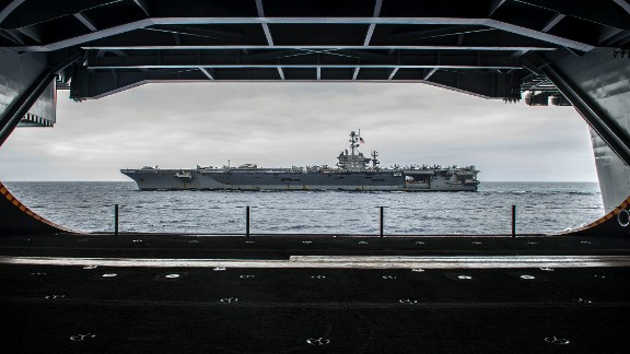 "The Nimitz-class aircraft carrier USS George Washington (CVN 73) is seen from inside its sister ship, the USS Ronald Reagan (CVN 76), on August 7 off the coast of California as the two ships prepare for a ""hull swap.""  Over 10 days in San Diego, much of the crew of each ship will transfer to the other. When completed, the Reagan will head to forward deployment in Japan, where the Washington had been. The Washington will head to Newport News, Virginia, for an overhaul."