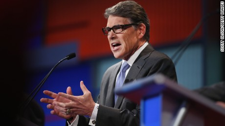 Rebulican presidential candidate Rick Perry fields a question during a presidential forum hosted by FOX News and Facebook at the Quicken Loans Arena August 6, 2015 in Cleveland, OH.