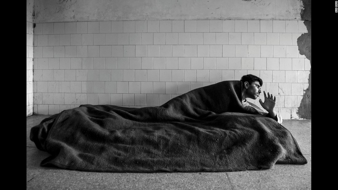 A man lies on a mattress in the hospital's chronic patients ward.