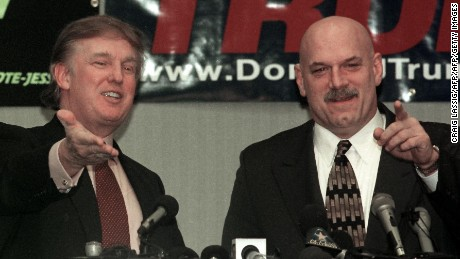 New York developer and potential Reform Party presidential candidate Donald Trump (left) and Minnesota Govenor Jesse Ventura (right) take questions at a news conference after Trump gave a speech at a Chamber of Commerce luncheon 07 January 2000 in Brooklyn Park, Minnesota, the city where Ventura was once mayor.