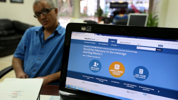Hisham Uadadeh enrolls in a health insurance plan under the Affordable Care Act with the help of A. Michael Khoury at Leading Insurance Agency on February 13, 2014 in Miami, Florida.