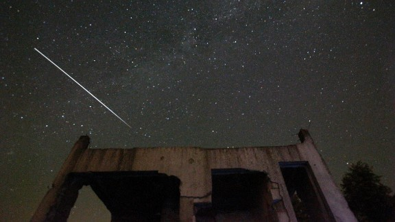 Stars and meteor streaks are seen behind a destroyed house, near Tuzla, Bosnia, August 12.