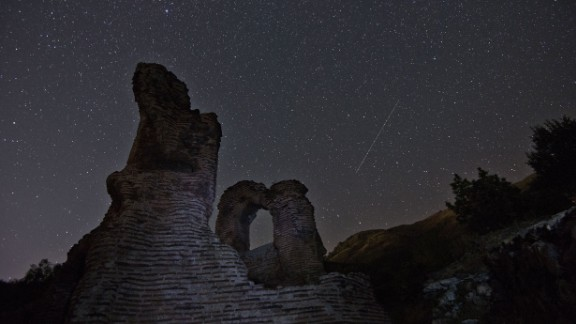 A long exposure image showing the Perseid meteor shower over the remains of an early Christian basilica in Bulgaria, early on August 12.