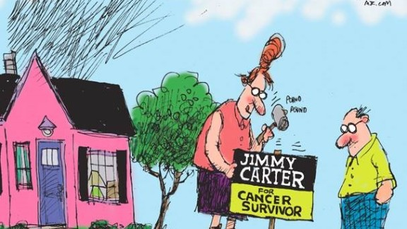 Cartoonist Mike Luckovich of the Atlanta Journal-Constitution draws get well wishes for Jimmy Carter