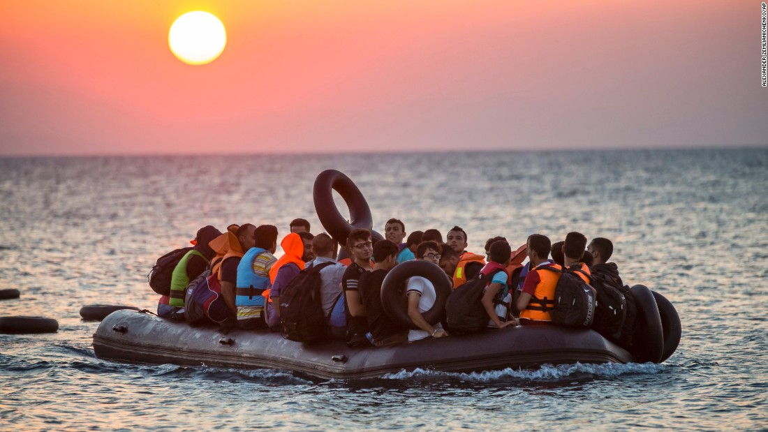 Migrants on a dinghy arrive at the island of Kos, Greece, after crossing from Turkey, on Thursday, August 13. Greece has become the main gateway to Europe for tens of thousands of refugees and economic migrants, mainly Syrians fleeing war, as fighting in Libya has made the alternative route from North Africa to Italy increasingly dangerous.