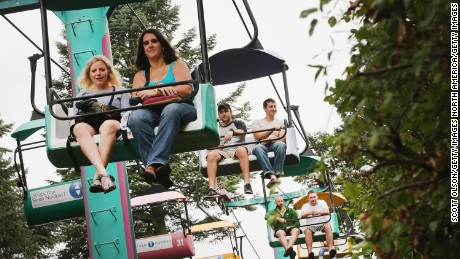 Visitors ride the Sky glider at the Iowa State Fair on August 7, 2014 in Des Moines, Iowa.