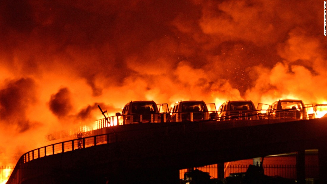 "Fire and smoke rise into the night sky <a href=""http://www.cnn.com/2015/08/13/asia/china-tianjin-explosions/index.html"">after multiple explosions</a> at a warehouse in Tianjin, China, early Thursday, August 13. The blasts in the northern Chinese port city killed at least 50 people, state media reported."