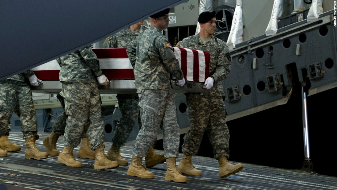An Army carry team transports the remains of Army 1st Sgt. Peter A. McKenna Jr., of Bristol, Rhode Island, at Dover Air Force Base, Delaware, on Monday, August 10. The 7th Special Forces Group to which he was assigned said that McKenna died Friday in Kabul, Afghanistan, during an attack on a NATO facility. McKenna was killed about a month after he was honored at the historic Fourth of July parade in his hometown.