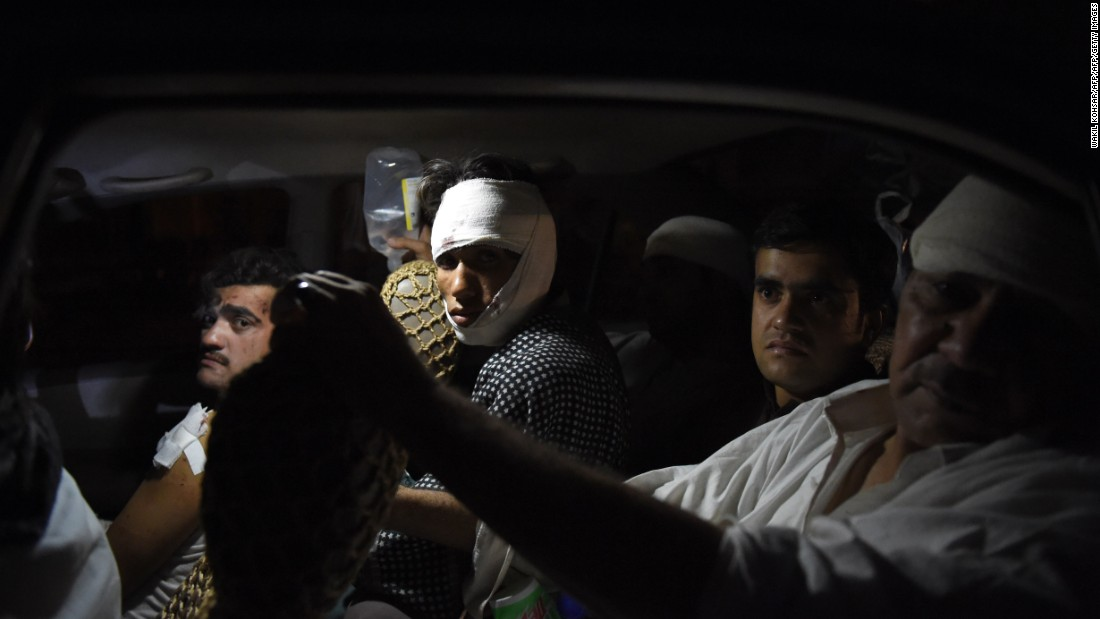 "Afghan men sit in a taxi as they go home after receiving treatment after a bomb in Kabul on Thursday, August 7.<a href=""http://www.cnn.com/2015/08/07/asia/afghanistan-truck-bomb/""> A truck exploded</a> on a main road in Afghanistan's capital Friday, killing 15 people and wounding 240 others, authorities said."