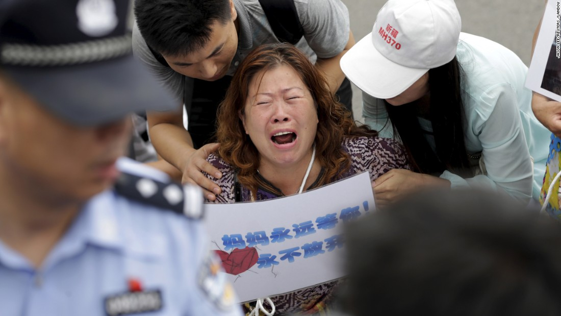 "A woman whose relative was aboard Malaysia Airlines flight MH370 cries next to family members on Friday, August 7, before a briefing given by Malaysia Airlines in Beijing. On Wednesday, August 5, Malaysia Prime Minister Najib Razak said the <a href=""http://www.cnn.com/2015/08/05/world/mh370-investigation/index.html"">piece of a plane wing that washed up on Reunion Island</a> in the Indian Ocean was part of missing Malaysia Airlines Flight 370. <a href=""http://www.cnn.com/2015/08/06/asia/mh370-malaysia-investigation-missteps/index.html"">Why family members don't believe it </a>"