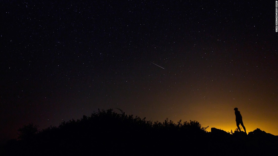 "A meteor illuminates the dark sky near Villadiego, northern Spain, during the  Perseid meteor shower on Wednesday, August 12. <a href=""http://www.cnn.com/2015/08/12/world/gallery/perseid-meteor-shower/index.html"">The Perseid meteor shower</a> occurs every August when the Earth passes through the debris and dust of the Comet Swift-Tuttle."
