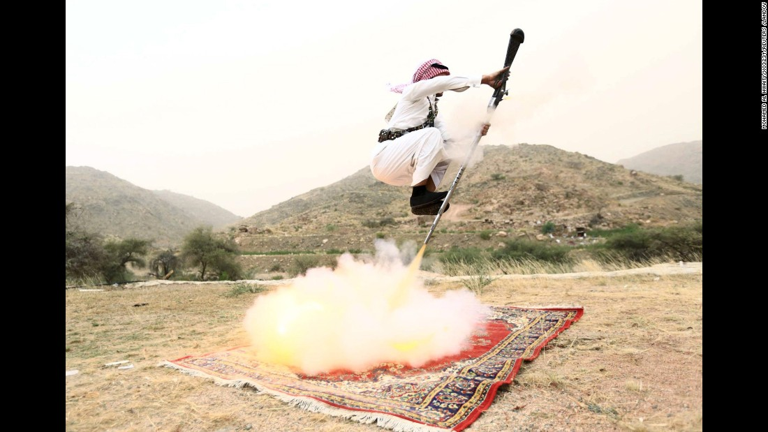 A man fires a weapon as he dances during a traditional celebration near Taif, Saudi Arabia, on Saturday, August 8.