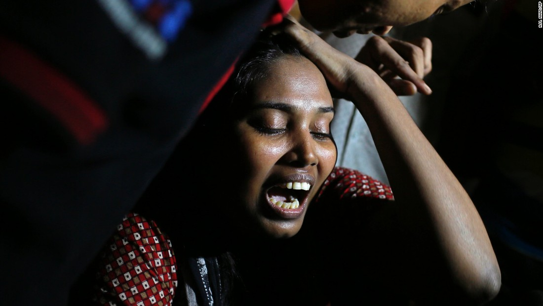 Ashamoni, wife of blogger Niloy Chatterjee, cries at her house in Dhaka, Bangladesh, on Friday, August 7. The secular blogger was hacked to death in his apartment, in the fourth deadly attack on bloggers there this year.