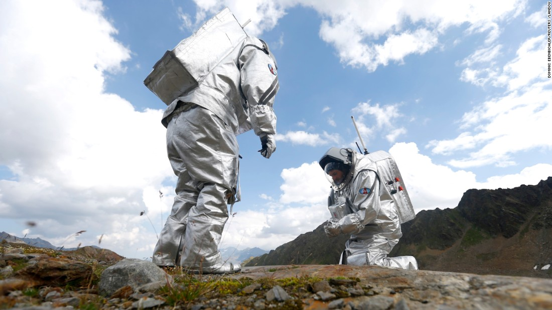 Inigo Munoz Elorza of Spain, left, and Stefan Dobrovolny of Austria take stone samples during a simulated Mars mission on Tyrolean glaciers in Kaunertal, Austria, on Friday, August 7. The glacier resembles the terrain on Mars.