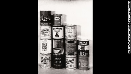 A selection of tins of different brands of coffee, including Brooke Bond, Lyons and Maxwell House, 1947.