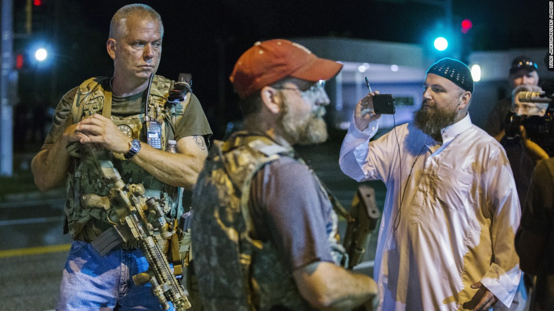 "Members of the Oath Keepers walk with their personal weapons on the street during protests in Ferguson, Missouri, on Tuesday, August 11. <a href=""http://www.cnn.com/videos/us/2015/08/12/oath-keepers-ferguson-intv-tsr.cnn/video/playlists/ferguson-missouri-michael-brown-investigation/"">Video: Heavily armed Oath Keepers patrol Ferguson</a>"