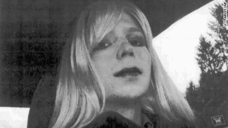 FILE - In this undated file photo provided by the U.S. Army, Pfc. Chelsea Manning poses for a photo wearing a wig and lipstick. A military prison psychologist is refusing to recommend that Manning's gender be officially changed to female on her Army employee-benefits file. Lawyers for the transgender solider imprisoned for leaking classified information made the assertion in a federal court filing Monday, Dec. 5, 2016, in Washington. (U.S. Army via AP, File)
