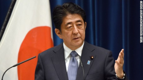 Japanese Prime Minister Shinzo Abe gestures as he answers questions following his war anniversary statement that neighboring nations will scrutinize for signs of sufficient remorse over Tokyo's past militarism at his official residence in Tokyo on August 14, 2015. Abe expressed deep remorse over World War II and said previous national apologies were unshakeable, but emphasized future generations should not have to keep saying sorry.