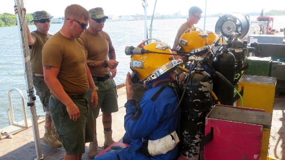 Two divers are sent to the bottom at a time, for a dive that often lasts more than an hour. A third diver is on standby, in case there is a medical or other serious problem.