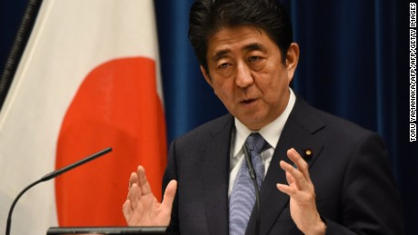 Japanese Prime Minister Shinzo Abe gestures as he answers questions following his war anniversary statement that neighbouring nations will scrutinise for signs of sufficient remorse over Tokyo's past militarism at his official residence in Tokyo on August 14, 2015.