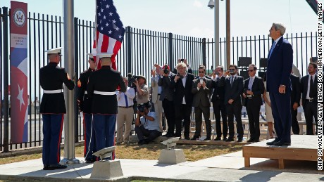 HAVANA, CUBA - AUGUST 14:  Secretary of State John Kerry (R) watches as Marines raise the American flag at the U.S. Embassy August 14, 2015 in Havana, Cuba. Kerry will visited the reopened embassy, the first time an American secretary of state has visited Cuba since 1945, a symbolic act after the the two former Cold War enemies reestablished diplomatic relations in July.  (Photo by Chip Somodevilla/Getty Images)
