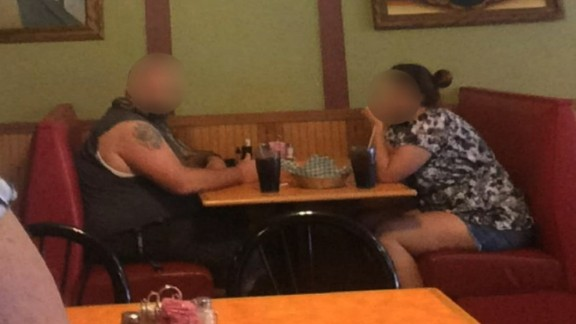 Photo from Lisa Loeffelholz captures couple with snake in Nixa, Missouri restaurant