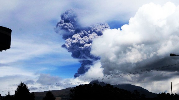 Cotopaxi, a volcano in Ecuador, sends large gray puffs of ash into the sky on August 14, 2015. Officials declared a yellow alert, the lowest level.
