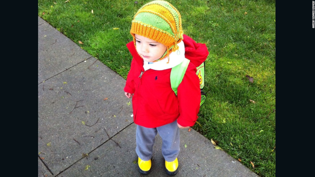 Little Liam waits for preschool in Palo Alto, California, with a backpack just big enough to hold his emergency clothes and a teddy bear.