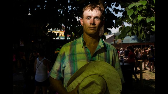 Ty Redman, 28, a farmer from Leon, Iowa, attends the fair. He has yet to decide whom he will vote for in the upcoming election.