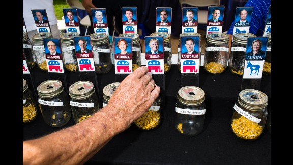 Fairgoers vote for presidential candidates with corn kernels on Thursday, August 13.