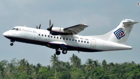 This is a file photo of a Trigana Air Service's ATR42-300 twin turboprop plane. The same type of a Trigana airliner carrying 54 people was missing Sunday, Aug. 16 after losing contact with ground control during a short flight in bad weather in the country's mountainous easternmost province of Papua, officials said. A search for the plane was suspended and will resume Monday morning.