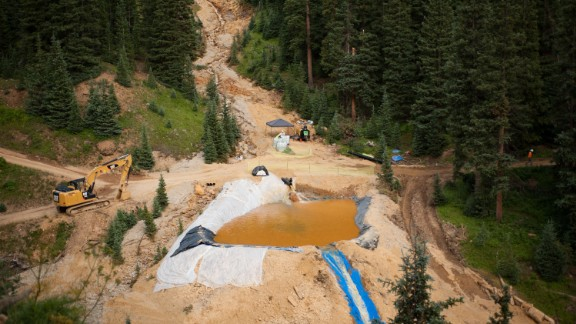 A settling pond is used on Tuesday, August 11, in Silverton, Colorado, at Cement Creek, which was flooded with millions of gallons of mining wastewater.  Settling ponds are used to reduce the acidity of mining wastewater so that it carries fewer heavy metals.