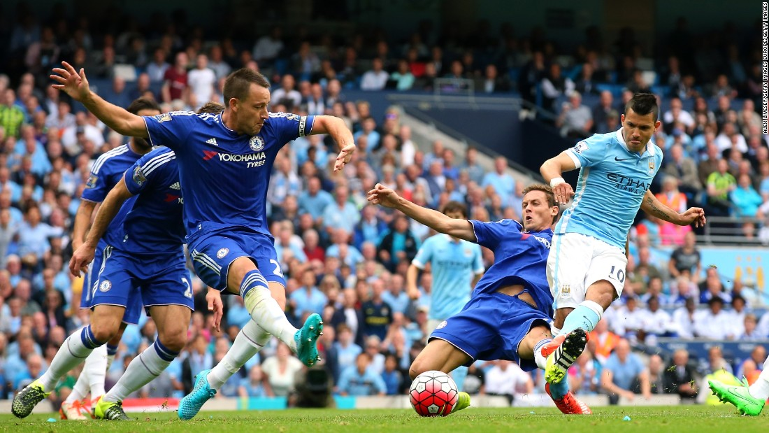 Manchester City's Argentine striker Sergio Aguero wriggles away from four Chelsea defenders to slot his side into the lead.